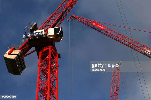 A crane with the logo of building contractor Carillion Plc stands on a construction site in London UK on Wednesday Jan 10 2018 Carillion Plc a UK...
