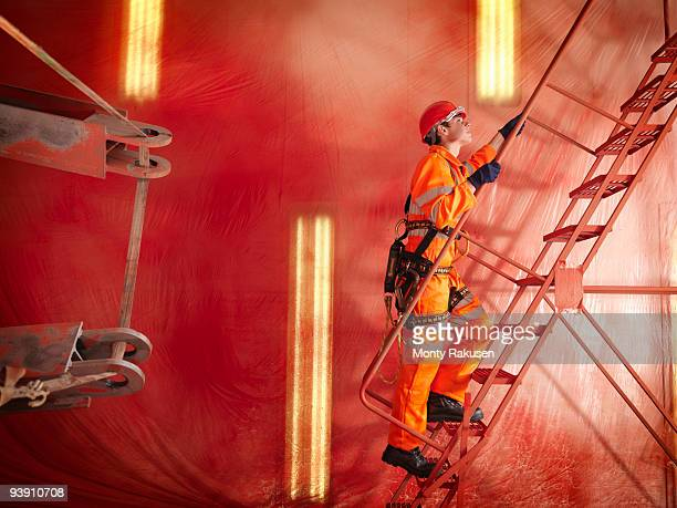 crane worker ascending stairs - safety harness stock photos and pictures
