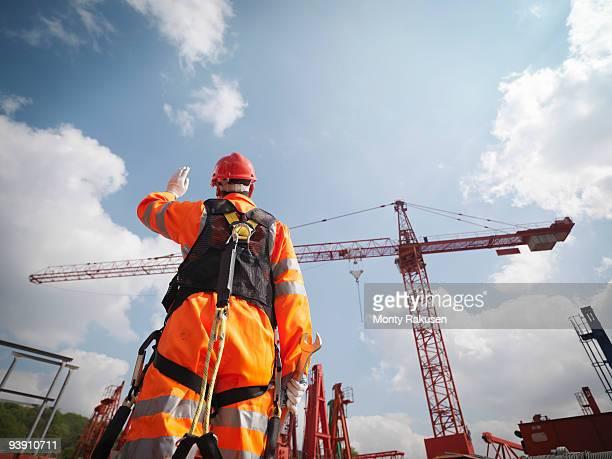 Crane Worker Directing Cranes
