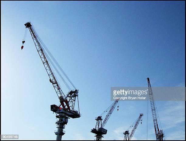 4 cranes against a blue sky