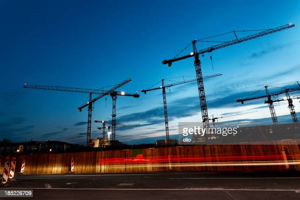 Cranes against blue sky at dusk