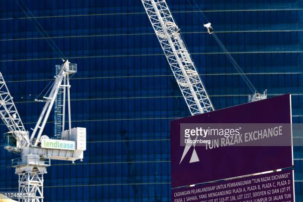 Cranes and a billboard stand near the under construction Exchange 106 building on the site of the Exchange TRX precinct in Kuala Lumpur Malaysia on...