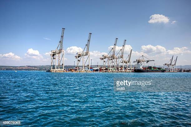 cranes and boats at koper docks in slovenia - koper stock photos and pictures