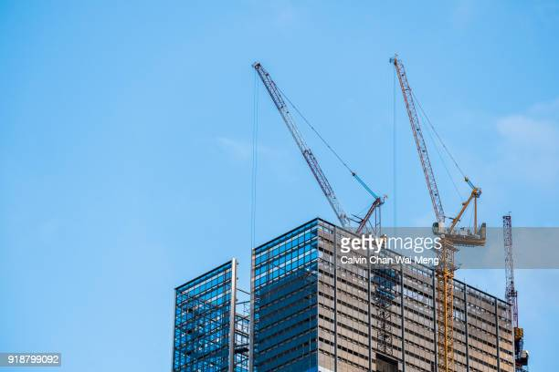 cranes and building - south east asia stock pictures, royalty-free photos & images