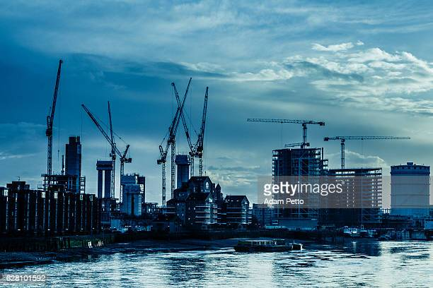Cranes and Construction by the Thames on London Skyline