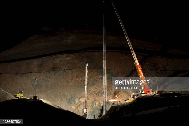 Cranes and diggers are pictured at the site where a child fell down a well in Totalan southern Spain on January 22 2019 The search for a toddler who...
