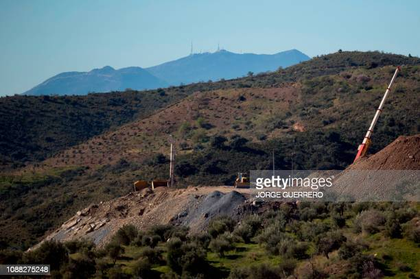 Cranes and diggers are pictured at the site where a child fell down a well in Totalan southern Spain on January 25 2019 A team of miners started...