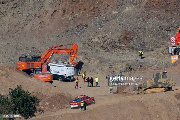 Cranes and diggers take part in the rescue works at the site where a child fell down a well in Totalan southern Spain on January 24 2019 Twoyearold...