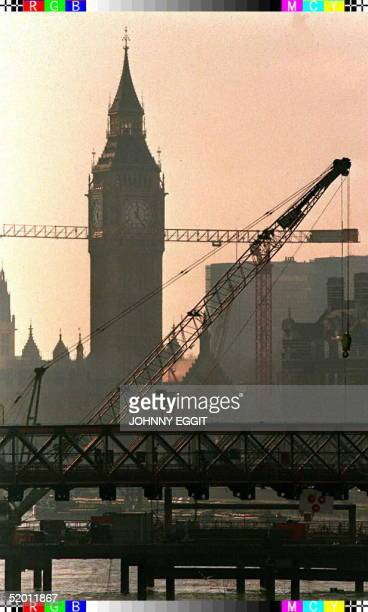 Cranes and the winter sunshine frame the capital' s famous landmark 'Big Ben' 24 January Piles are driven into the base of the River Thames as part...