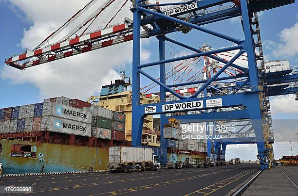 Cranes and trucks get ready near a container ship on May 5 2015 in the Doraleh harbour in Djibouti AFP PHOTO / CARL DE SOUZA