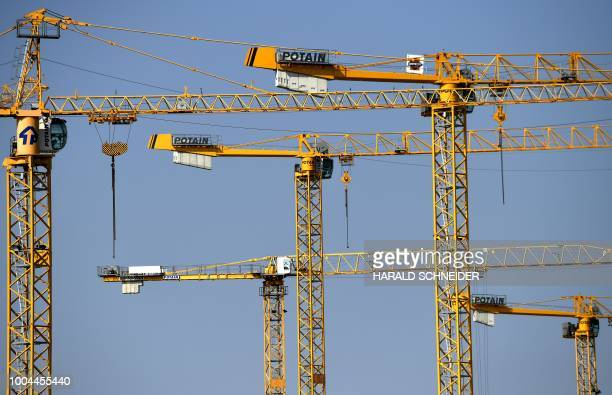 Cranes are pictured at a construction site in Vienna Austria on July 23 2018 / Austria OUT
