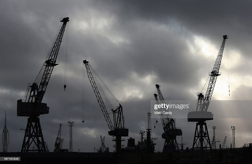 Cranes are seen at the HM Naval Base in Portsmouth dockyard, the Portsmouth home of BAE Systems, following the announcement that the company will be cutting jobs on November 6, 2013 in Portsmouth, England. The cuts are being made following a decline in orders, with 1775 jobs going between the yards in Scotland and England with the end of shipbuilding altogether at the Portsmouth yard.