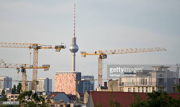 Cranes are seen in Kreuzberg area in front of the TVTower in Berlin downtown on May 25 2014 in Berlin Germany