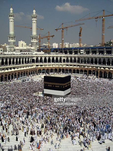 Cranes are seen in the background at construction sites behind Mecca's Grand Mosque on December 3 2008 as Muslims from all over the world are...