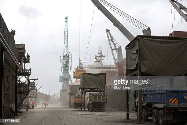 Cranes are seen unloading 'Clinker' from bulk carrier ships and into waiting trucks while on the dockside at Mombasa port managed by the Kenya Ports...