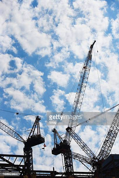 cranes at construction site - crane construction machinery stock pictures, royalty-free photos & images