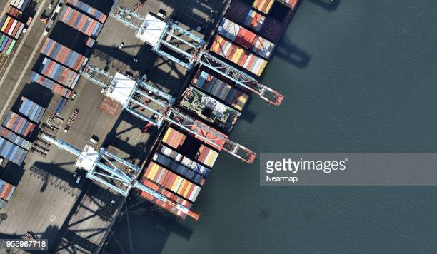 Cranes at harbour with containers