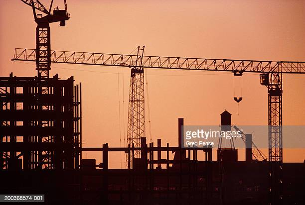 """cranes at highrise construction site (digital enhancement) - """"greg pease"""" stock pictures, royalty-free photos & images"""