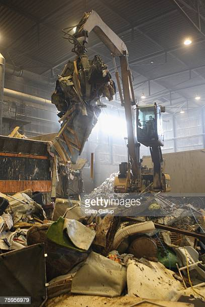 A crane's claw begins sorting garbage at a garbage processing center August 3 2007 in Nuemuenster Germany The center known as a MechanischBiologisch...