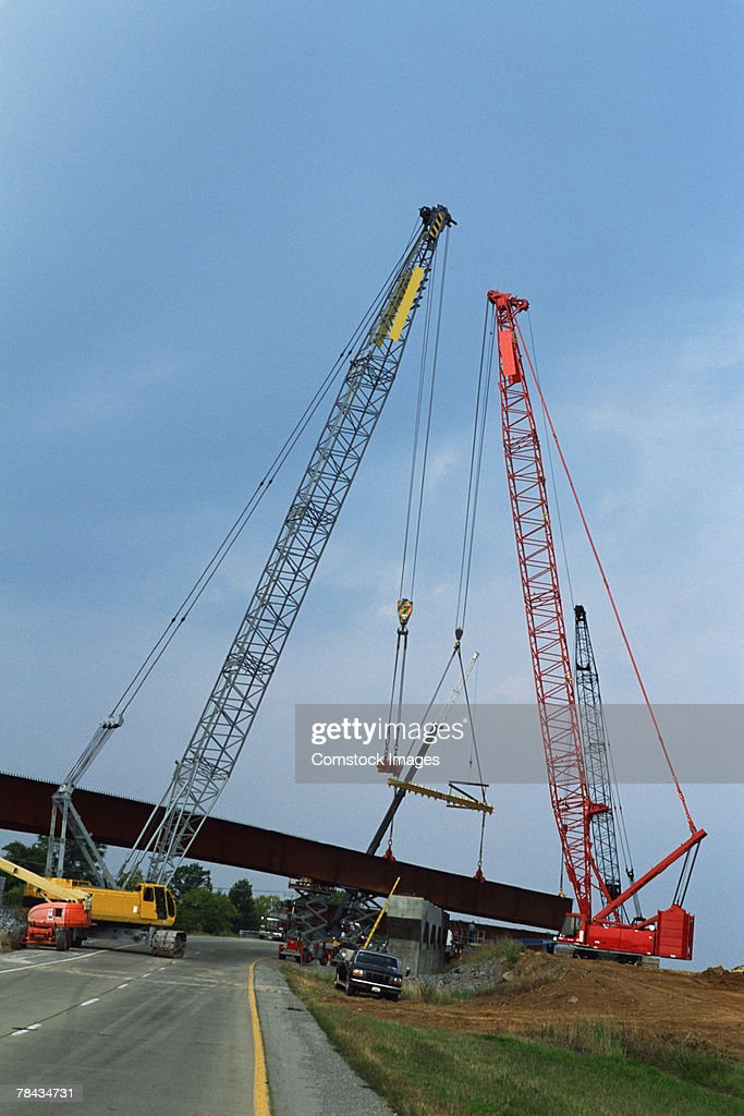 Cranes constructing overpass : Stockfoto