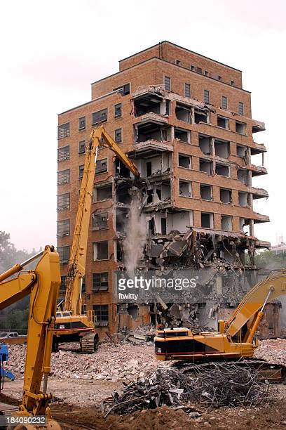 cranes demolishing a brick building - demolishing stock pictures, royalty-free photos & images