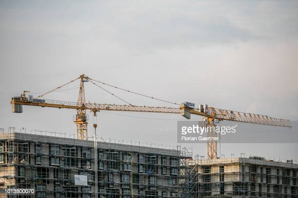 Cranes for house construction are pictured on August 08 2018 in Berlin Germany