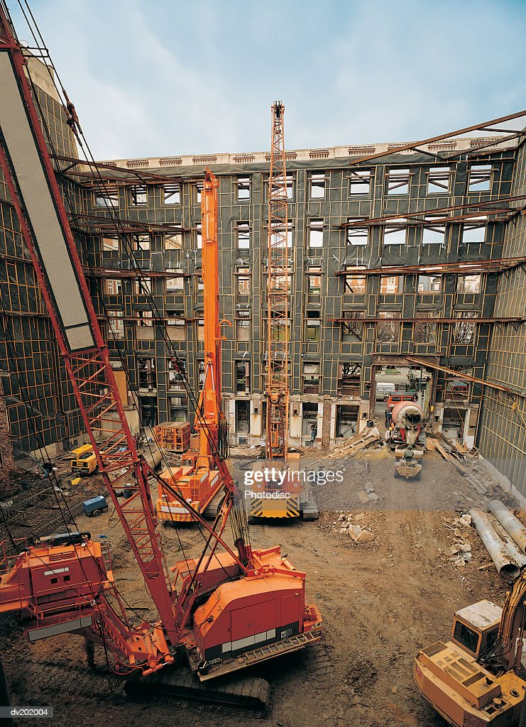 Cranes inside of building structure : Stock Photo