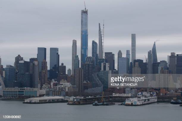 A cranes is seen diging on Pier 90 where the USNS Comfort will Dock next week on March 28 in Weehawken New Jersey US President Donald Trump said on...