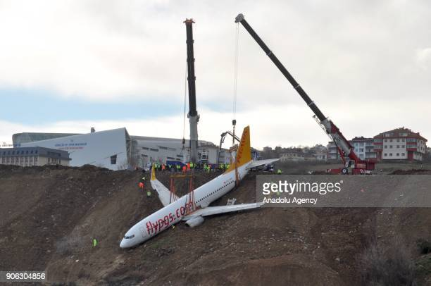 Cranes lift Pegasus airplane which was stucked in mud as it skidded off the runway after landing in Trabzon Airport Turkey early Sunday on January 18...