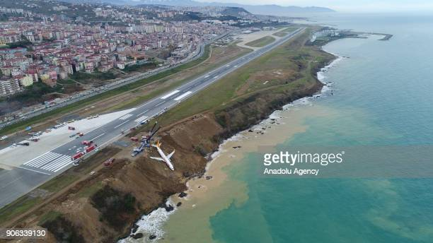 Cranes lift Pegasus airplane which was stucked in mud as it skidded off the runway after landing in Trabzon Airport Turkey on January 18 2018
