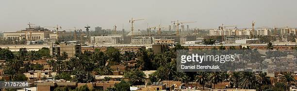 Cranes litter the skyline as construction workers continue work on the new United States Embassy compound in Baghdad's fortified Green Zone on August...