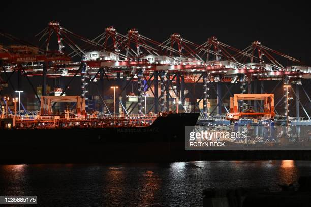 Cranes move containers at the Port of Los Angeles, in Los Angeles, California, October 14, 2021. - The Port of Los Angeles and its longshoreman union...