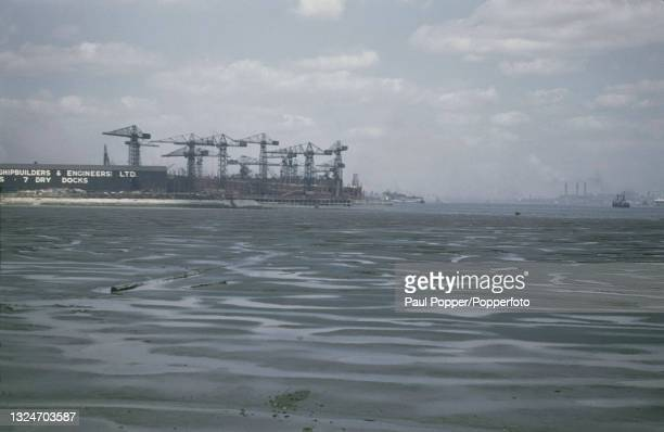 Cranes of the Cammell Laird shipbuilding company rise up above the town of Birkenhead on the west bank of the River Mersey opposite the city of...