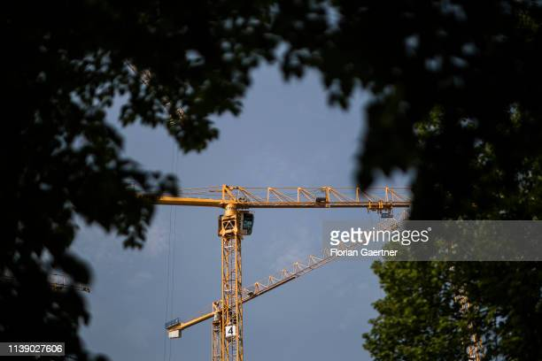 Cranes on a construction site are pictured on April 24 2019 in Berlin Germany