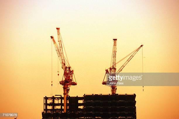 Cranes on construction site at dusk