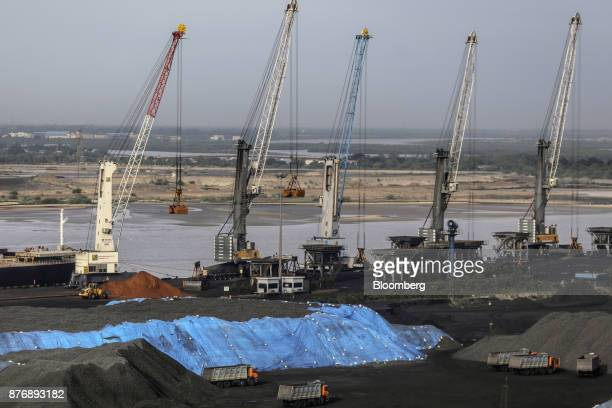 Cranes operate as trucks sit parked at Krishnapatnam Port in Krishnapatnam Andhra Pradesh India on Saturday Aug 12 2017 Growth in gross domestic...