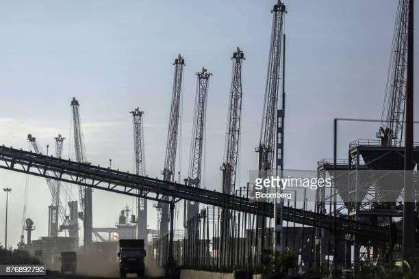 Cranes operate as trucks travel though Krishnapatnam Port in Krishnapatnam Andhra Pradesh India on Saturday Aug 12 2017 Growth in gross domestic...