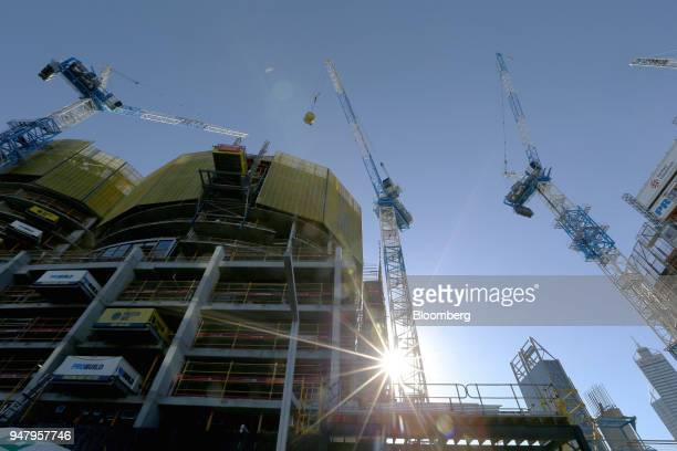 Cranes operate at a construction site in the Elizabeth Quay area of Perth Australia on Wednesday April 11 2018 Australia is scheduled to release...