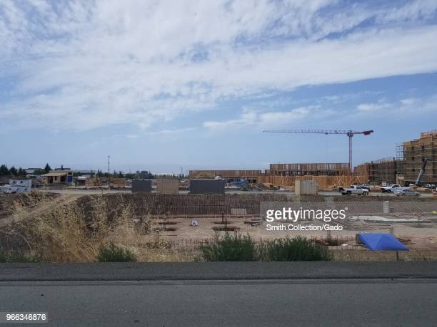 Cranes operate at a large construction site near the 680 Freeway on the outskirts of the Silicon Valley Fremont California May 30 2018