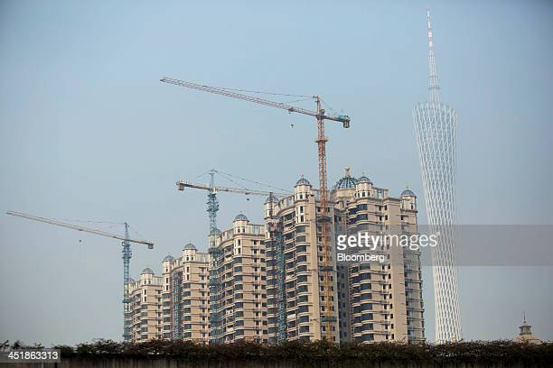 Cranes operate at a residential construction development near Canton Tower right in the Haizhu district of Guangzhou Guangdong Province China on...
