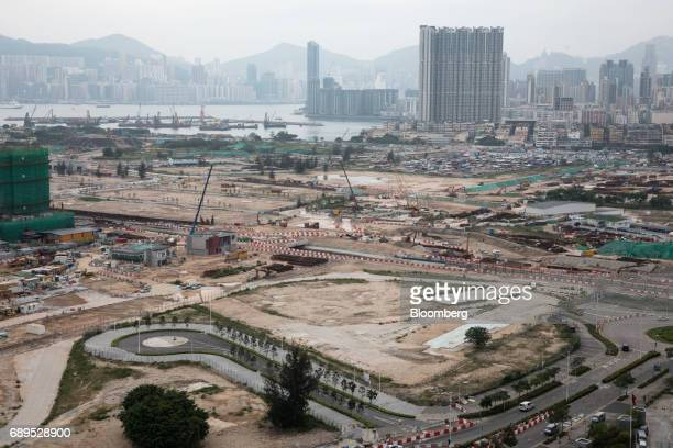 Cranes operate at land sites under construction at the former Kai Tak airport area in Hong Kong China on Friday May 26 2017 HNA Group Co has been...