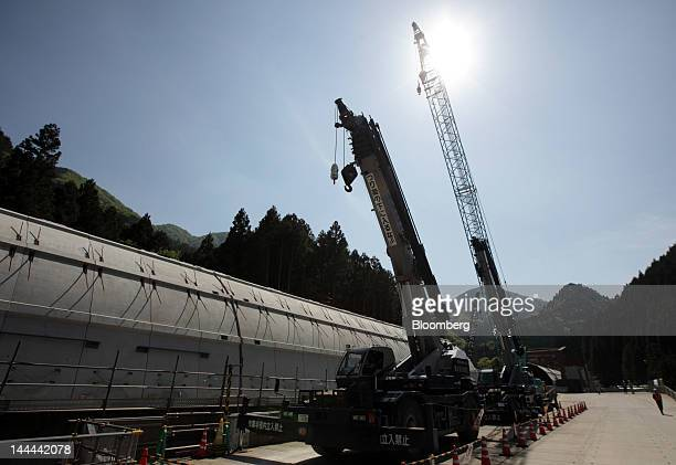 Cranes operate outside the Akiyama tunnel which is under construction for Central Japan Railway Co's magneticlevitation train line in Uenohara City...