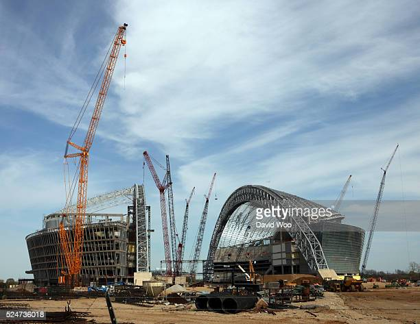 Cranes overlook construction on the new Dallas Cowboys stadium which is more than halfway complete