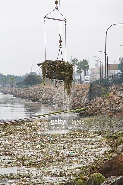 Cranes picking up garbage debris after first rain of the season The Garbage boom on the Los Angeles River in Long Beach was built in 2001 Urban...