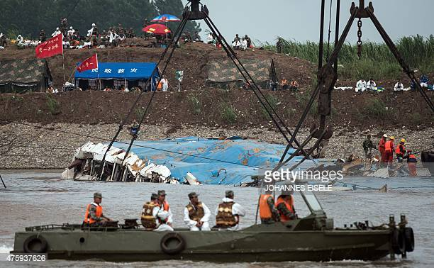Cranes raise the sunken passenger ship in the Yangtze river in Jianli in China's Hubei province on June 5 2015 Authorities admit there is no hope for...