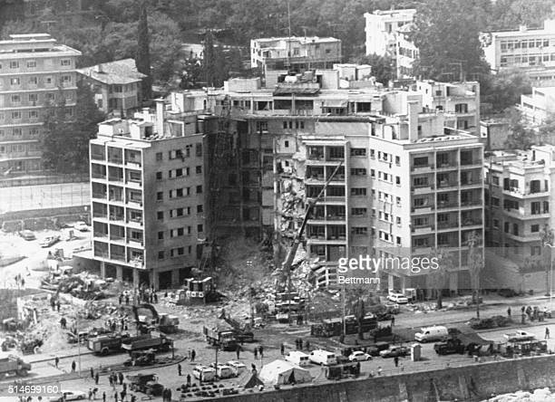 Cranes remove rubble from the site of the American Embassy in Lebanon after a terrorist bombing 1983