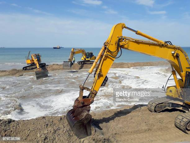 Cranes removing sand from the bottom of the sea to fill the beach