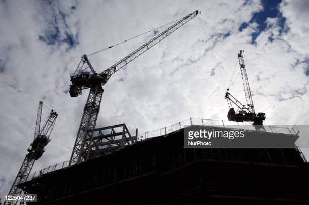 Cranes rise from a construction site above Tottenham Court Road station in London, England, on July 6, 2020. England took major steps towards the...