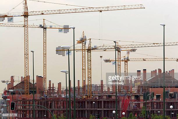 Cranes seen at a construction site in Madrid Spain Monday May 9 2005 ACS and Grupo Ferrovial SA Spain's biggest builders may this week say...