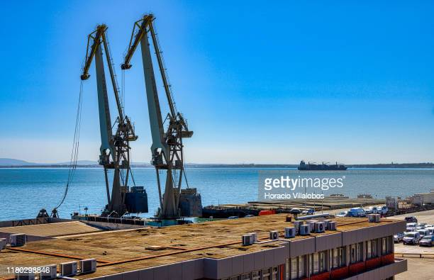 Cranes seen at TSA Santa Apolonia multipurpose container terminal on October 10 2019 in Lisbon Portugal Lisbon harbor is one of the largest and most...